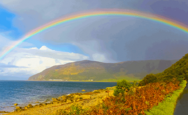 A rainbow over water