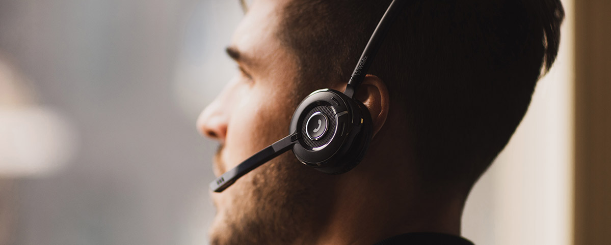 A wildix kite headset on a call centre user